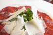 Carpaccio met rucola en balsamicodressing recept